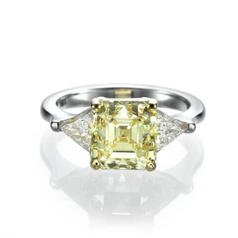 Balto aukso žiedas su geltonu deimantu ir deimantais