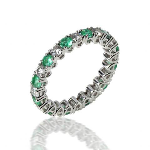 Balto aukso žiedas su smaragdais ir deimantais